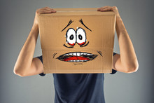 Fototapete - Man with cardboard box on his head and terrified look skethed