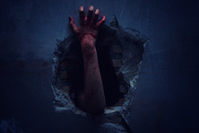 Fototapete - Horror Scene with bloody hand of evil is coming from a dark hole.