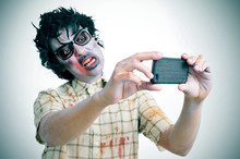 Fototapete - zombie taking a selfie, with a filter effect